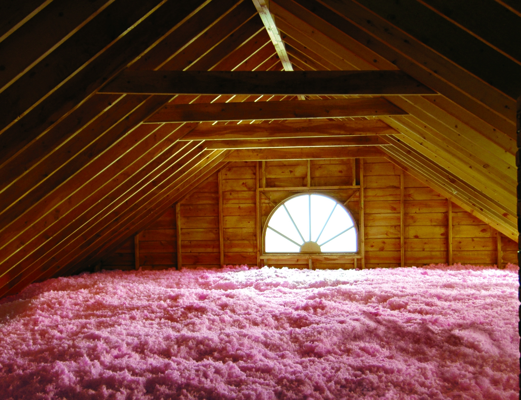 Image of loose fill fiberglass insulation installed in an attic