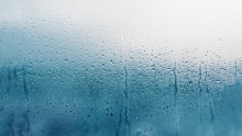 humid home, condensation collecting on window of home