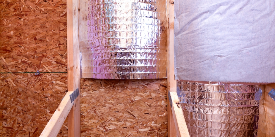 radiant barrier partially installed in attic of house