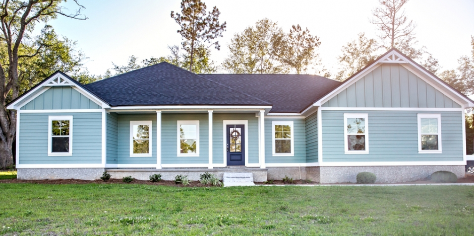 front view of a one story blue house