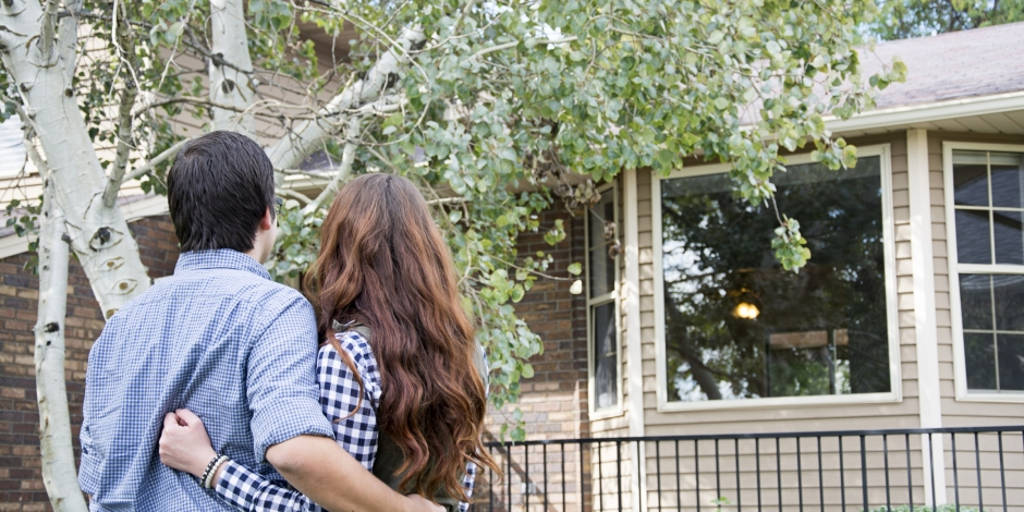 Couple Holding Each other in Front of New House