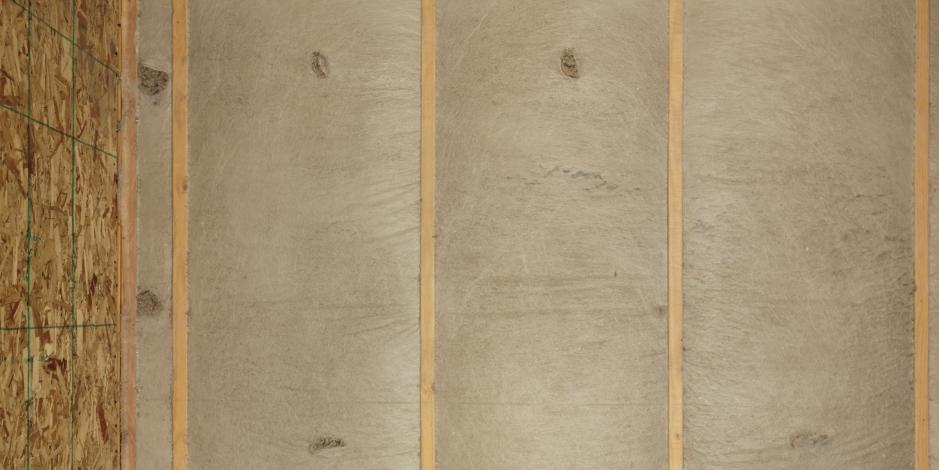 brown blown-in fiberglass insulation in attic